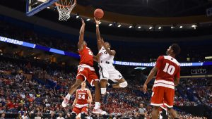 Mar 20, 2016; St. Louis, MO, USA; Xavier Musketeers guard Edmond Sumner (4) shoots while guarded by Wisconsin Badgers forward Khalil Iverson (21) during the second half in the second round of the 2016 NCAA Tournament at Scottrade Center. Mandatory Credit: Jasen Vinlove-USA TODAY Sports